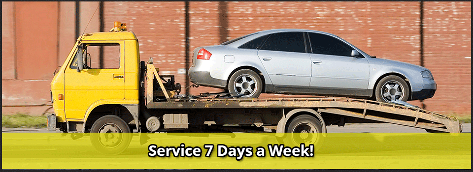 Service 7 Days a Week! - car on flatbed truck